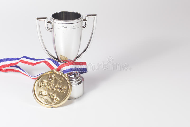 Winners gold medal and silver trophy stock images