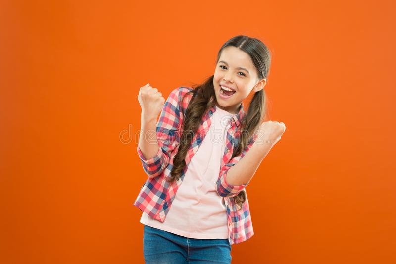 Winners never quit and quitters never win. Successful happy kid. Achieve success. Kid cheerful celebrate victory. Girl royalty free stock photography