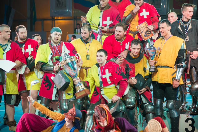 Winners of the tournament. MOSCOW - JANUARY 03, 2016: the Winners of the tournament. Armored fighters , dressed as knights, fighting at the XI World championship stock image