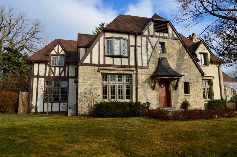 Winnetka Tudor. This is a early winter picture of a large home in Winnetka, Illinois. This example of a Tudor style of architecture was built in 1925. This royalty free stock images