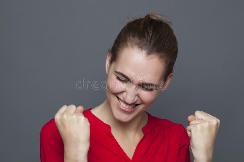 Winning behavior concept for energetic 20s girl stock photo