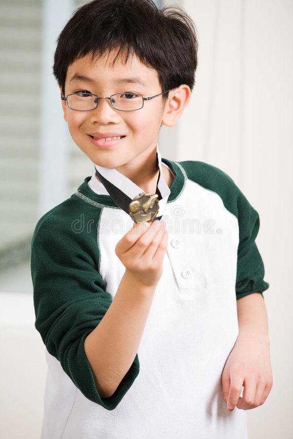 Winning boy with his medal royalty free stock image