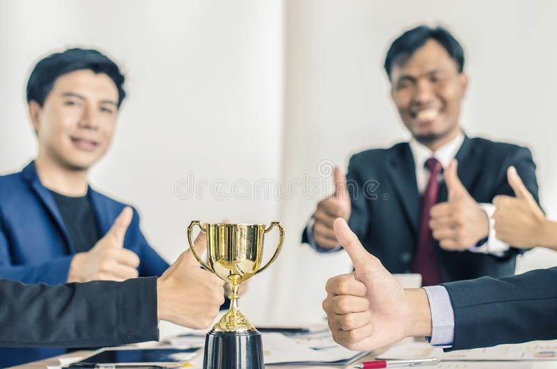 Winning business team gold trophy , business team happy consent royalty free stock photos