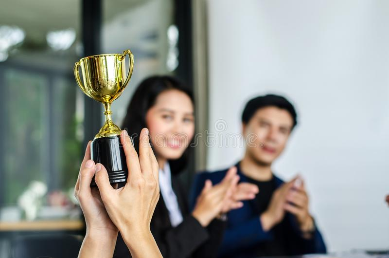 Winning business team gold trophy , business team happy royalty free stock photography
