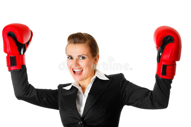 Winning business woman wearing boxing gloves royalty free stock photos