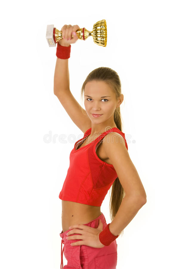 Winning Cup. Girl holding winning cup on white background stock image