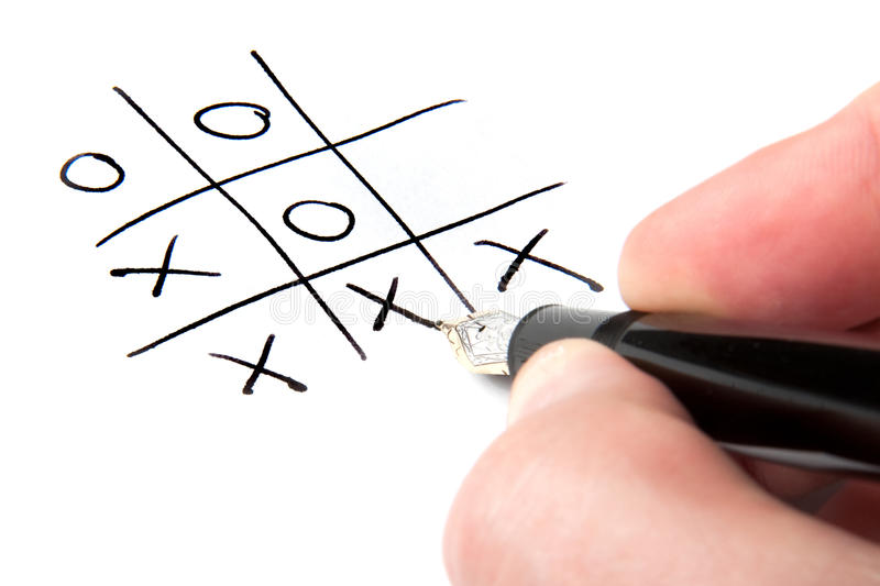 Winning the Game. A male hand winning at tic-tac-toe stock photography