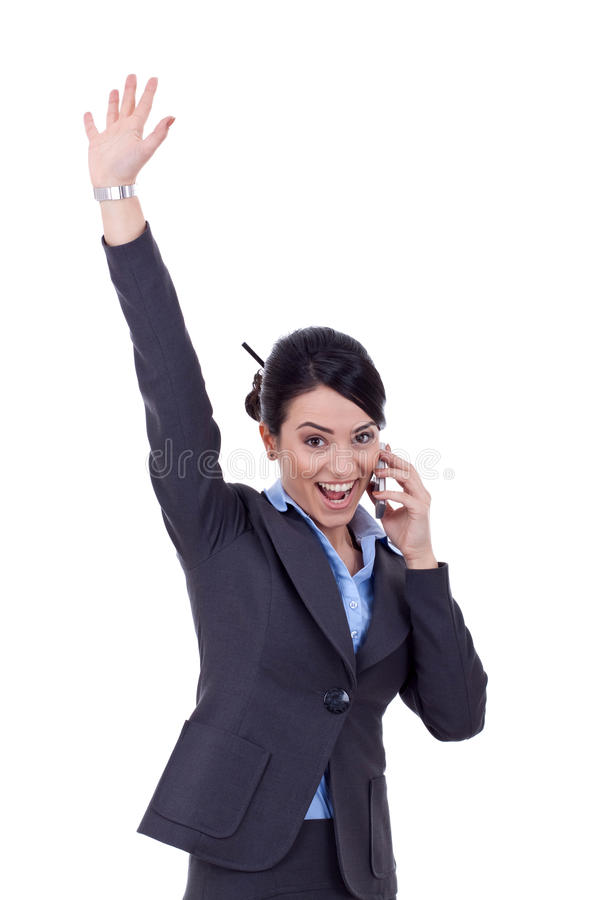 Winning on phe phone. Attractive business woman on the phone winning over white stock photos