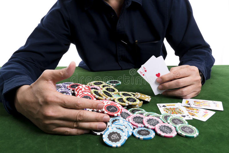 The winning poker card gather a pile of chips royalty free stock photo