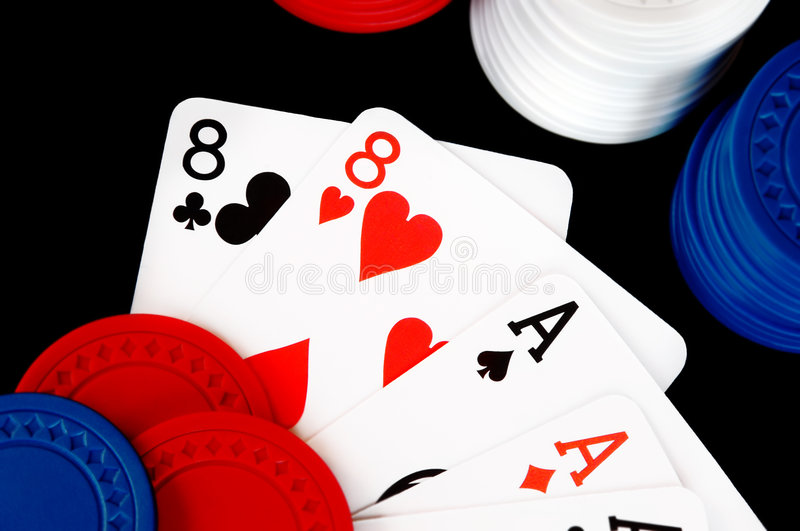 Winning Poker Hand With Chips. On a black background royalty free stock photos