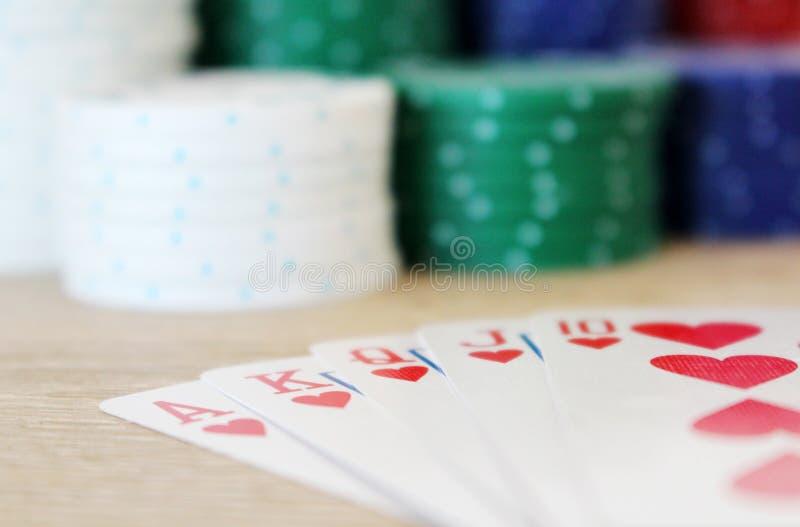 Winning poker hand with royal straight flush stock photos