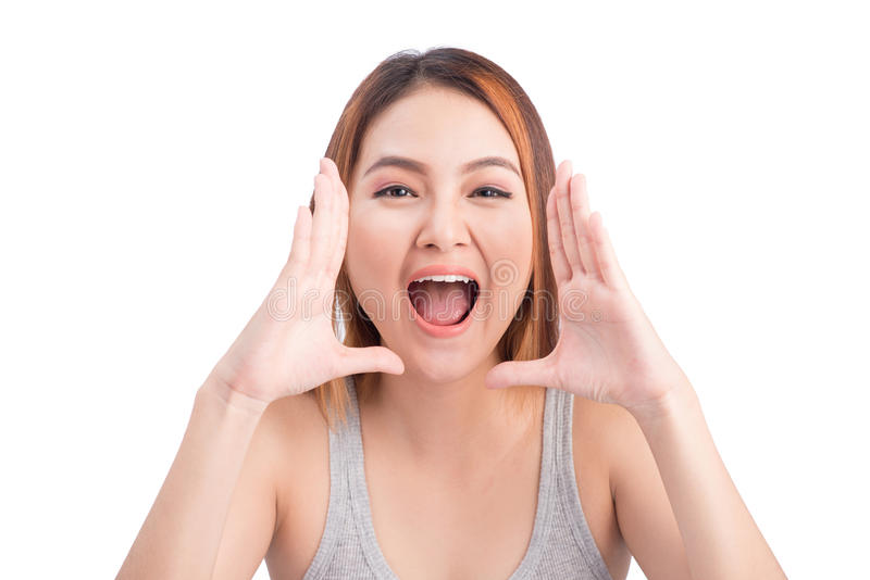 Winning success asian woman screaming isolated on white background waist up. stock images