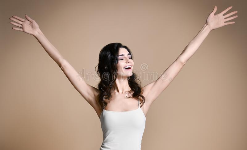 Winning, success , and life goals concept. Young woman with arms in the air giving thumbs up royalty free stock photos