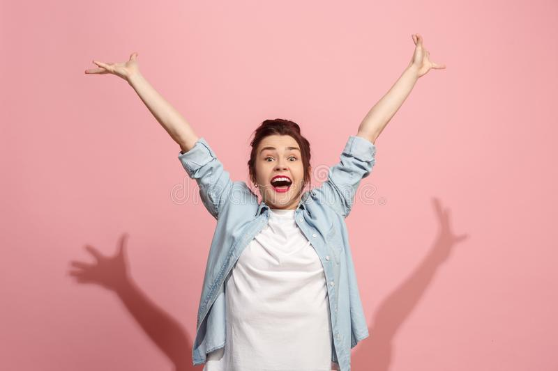 Winning success woman happy ecstatic celebrating being a winner. Dynamic energetic image of female model royalty free stock images