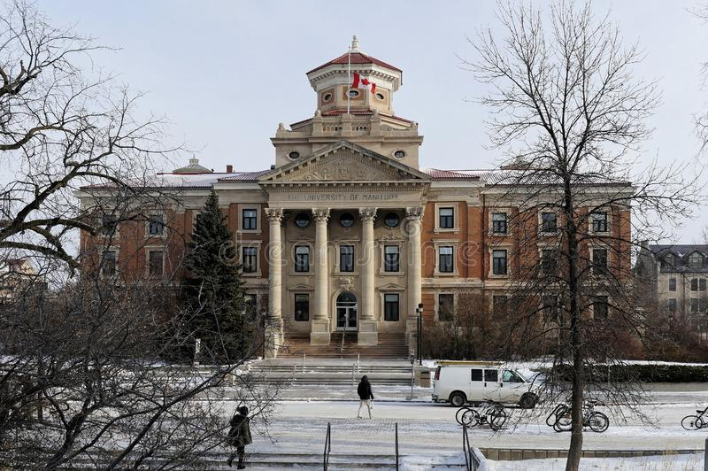 WINNIPEG, CANADA - 2014-11-19: De wintermening over Universiteit van de het Beleidsbouw van Manitoba stock fotografie