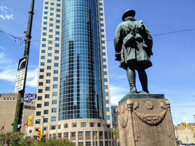 The century old First World War Soldier statue overlooking Portage and Main in Winnipeg royalty free stock photography