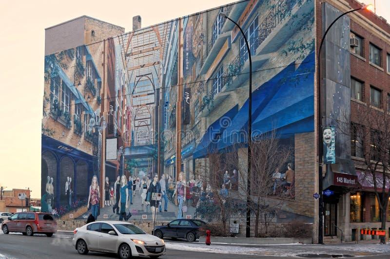 Winnipeg Manitoba, Kanada - 2014-11-24: En konstsammansättning på väggen av avebyggnad för 145 marknad royaltyfri bild