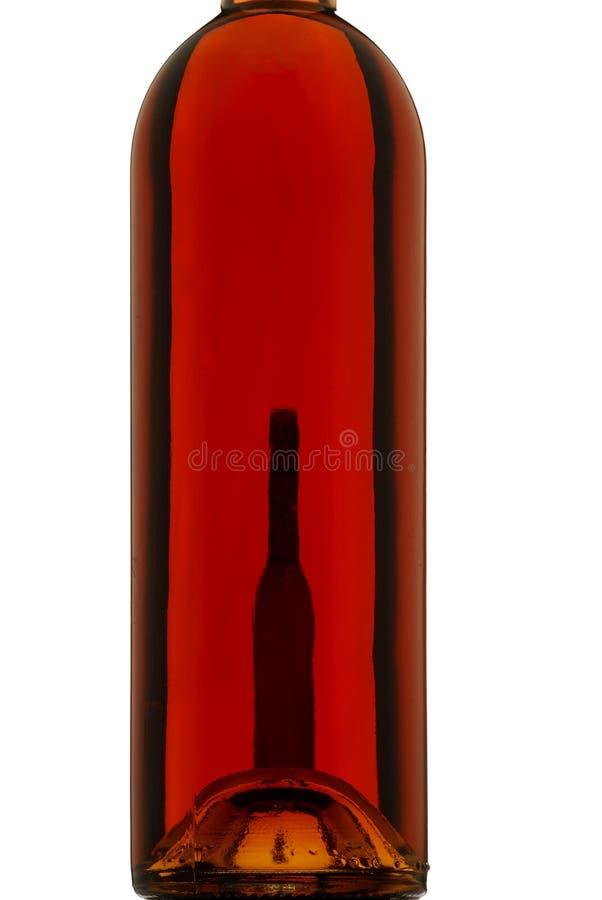 Wino butelka, backlight, biały tło, różany wino obraz stock