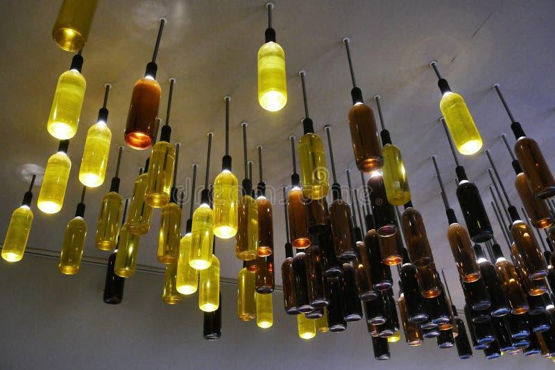 Wino butelki jako lampy instalować na suficie zdjęcie stock