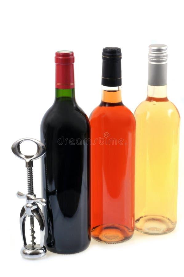 Wino butelki z corkscrew na białym tle zdjęcia royalty free