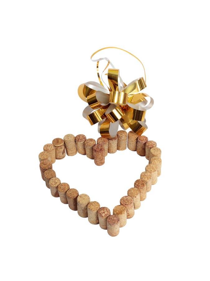 Wino korki w postaci serca i złotego łęku obrazy royalty free