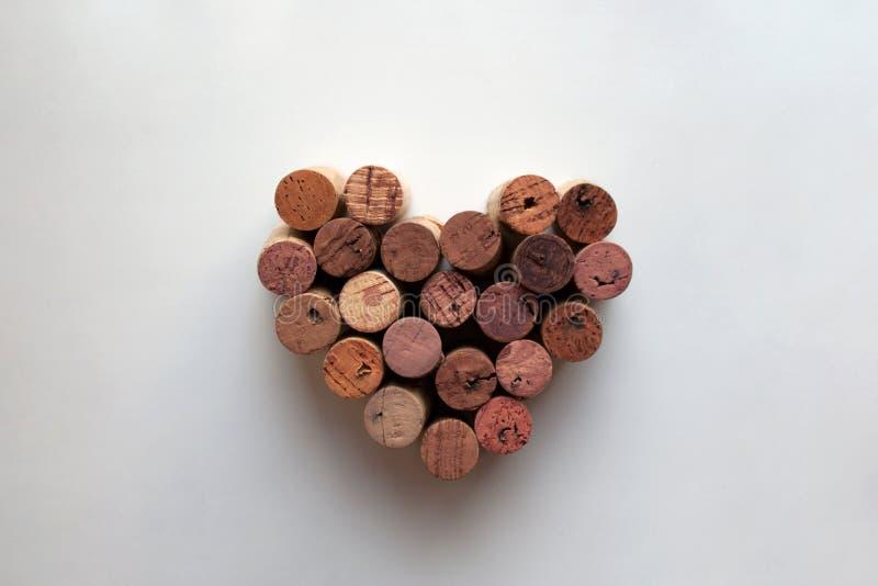 Wino korkuje serce kształtującego valentine zdjęcie royalty free