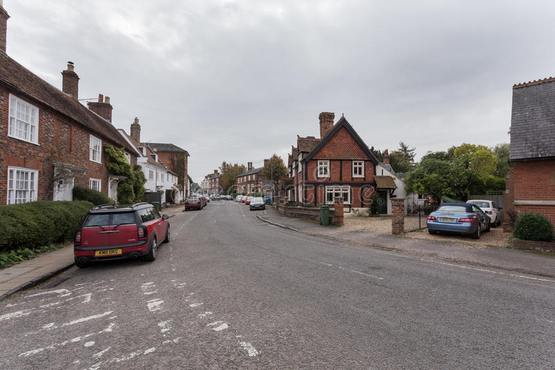 Winslow, Buckinghamshire, United Kingdom, October 25, 2016: Brick houses and cottages on the Horn street on grey chilly morning. royalty free stock photos