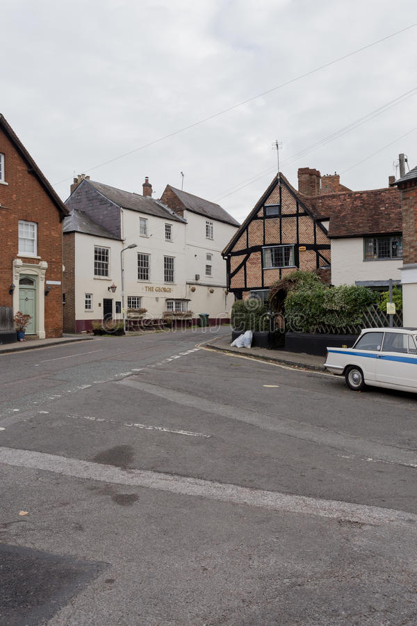 Winslow, Buckinghamshire, United Kingdom, October 25, 2016: Cottages and Pub The George Winslow on the Horn street on grey chilly. Morning royalty free stock photography