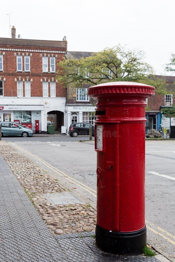 Winslow, Buckinghamshire, United Kingdom, October 25, 2016: Royal Mail red post box on Market Square, Winslow. stock photo