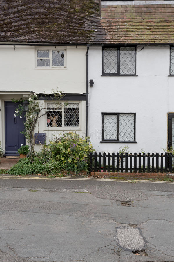 Winslow, Buckinghamshire, United Kingdom, October 25, 2016: Two. Cottages with tiny front gardens on the Bell Walk, Winslow royalty free stock photography