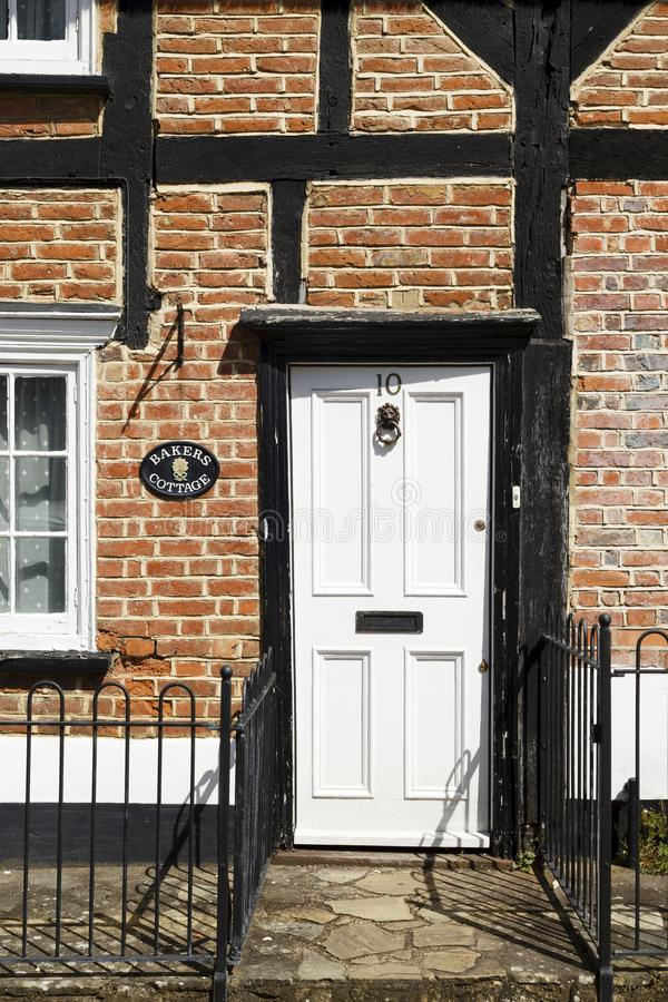 Front door to an old English cottage royalty free stock image