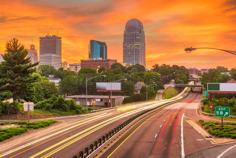 Winston-Salem, North Carolina, USA skyline at dusk. Winston-Salem, North Carolina, USA skyline and highways at dusk royalty free stock photos