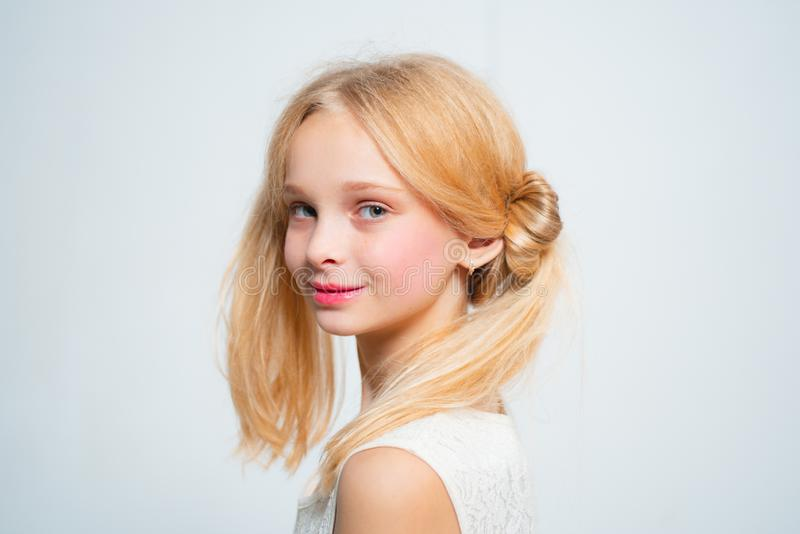 Wintage teen style. Happy blond teenager girl. Skincare and natural makeup for retro blonde teen. Beauty hairdresser royalty free stock images
