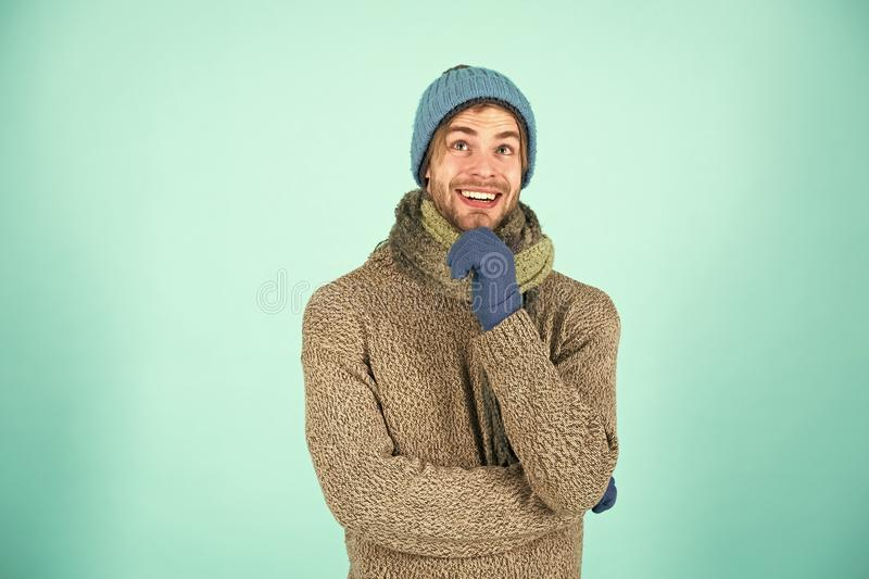 Winter accessories concept. Winter fashion knitted clothes. Knitted accessories as hat and scarf. Man knitted hat gloves royalty free stock photography