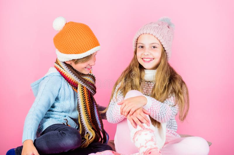 Winter accessories for kids. Girl and boy wear knitted winter hats. Winter season fashion accessories and clothes stock photography