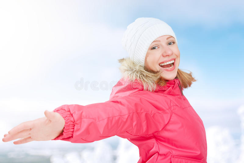 Winter activities in nature. happy girl with open hands enjoying life royalty free stock image
