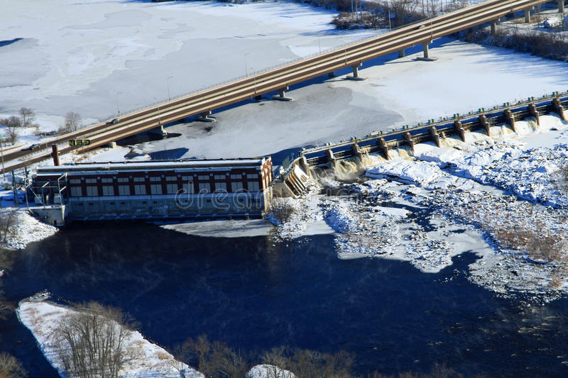 Winter aerial hydroelectric dam Chippewa Falls Wisconsin. An aerial view of the Chippewa River, the dam originally built by Northern States Power in Chippewa royalty free stock photos