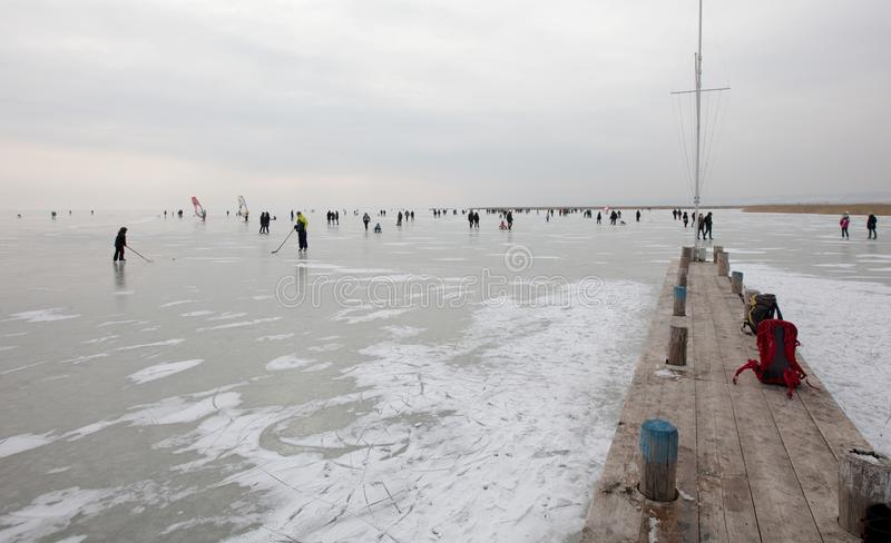 People on frozen Lake stock images