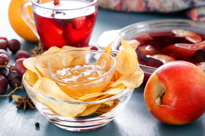Winter alcoholic drinks - mulled wine, punch, grog with cornflakes Glass glasses with mulled wine. Hot fruit tea. royalty free stock image