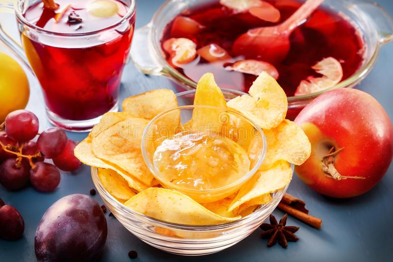 Winter alcoholic drinks - mulled wine, punch, grog with cornflakes Glass glasses with mulled wine. Hot fruit tea royalty free stock images