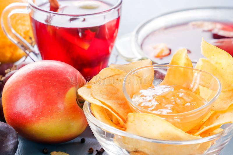 Winter alcoholic drinks - mulled wine, punch, grog with cornflakes Glass glasses with mulled wine. Hot fruit tea. Spices, fruit. stock images