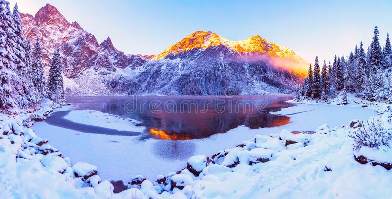 Winter Alps. Italian Alps with snow at sunrise. Mountains illuminated with rising sun. Picturesque winter mountain landscape royalty free stock photo