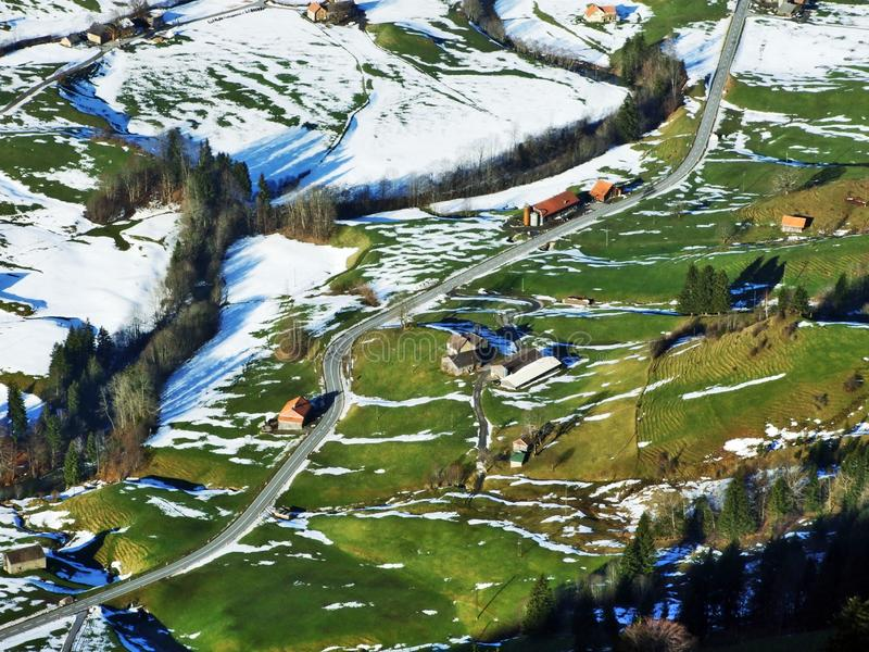 Winter ambiance on pastures and farms in the Urnasch municipality. Canton of Appenzell Ausserrhoden, Switzerland royalty free stock photo