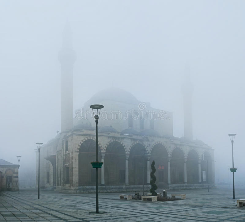 The winter in Anatolia. The hard mist hides the beauty of Selimiye Mosque, showing only its silhouette, Konya, Turkey royalty free stock image