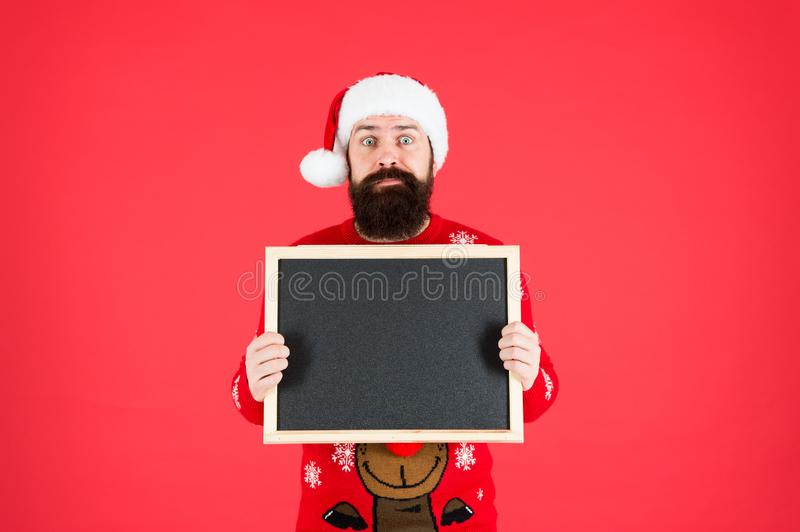 Winter announcement. Winter event. Winter holiday. Bearded man blank blackboard copy space. Guy santa claus red royalty free stock images