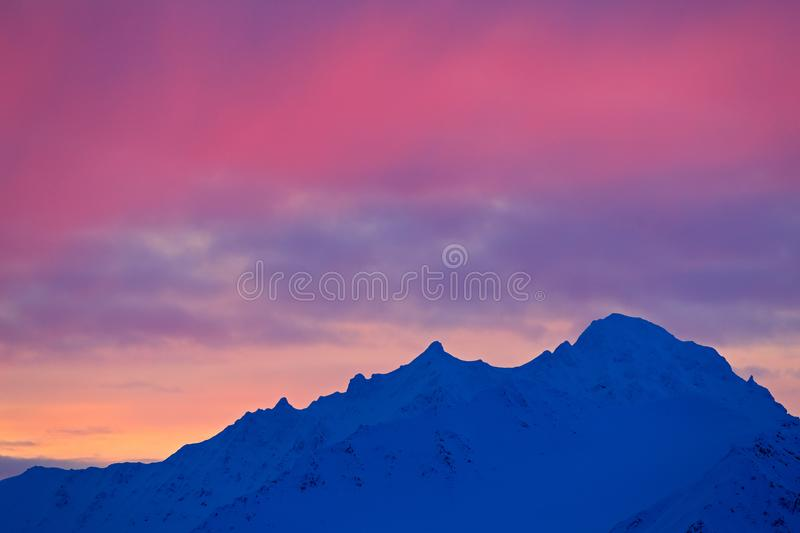 Winter Arctic. White snowy mountain, blue glacier Svalbard, Norway. Ice in ocean. Iceberg twilight in North pole. Pink clouds with. Mountain stock photography