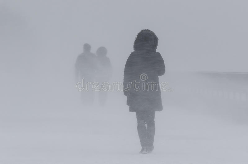 WINTER ATTACK - PEOPLE IN BLIZZARD stock images