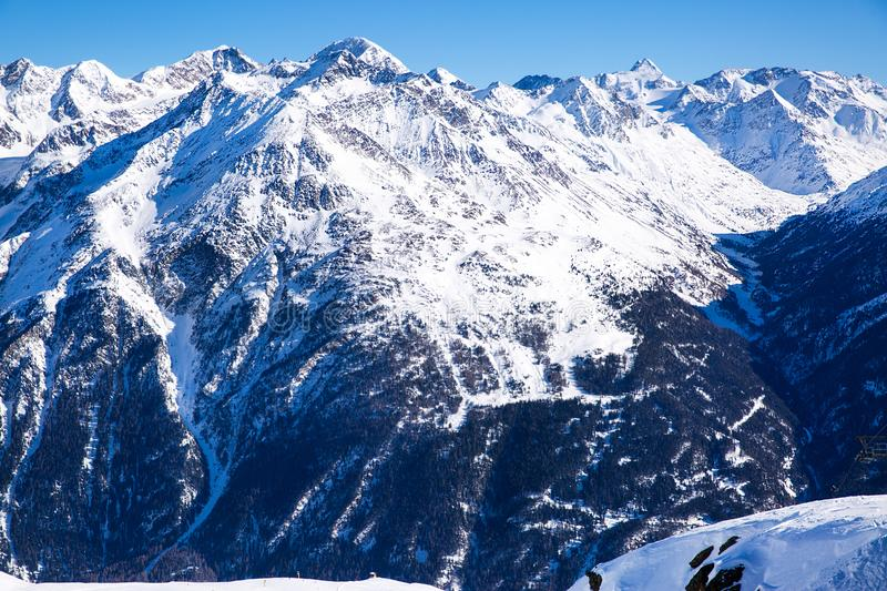 WInter in Austrian Alps, high mountains, covered with snow. Winter in an Austrian Alps, Tyrol. High mountains covered with snow. Bright sunny day stock images