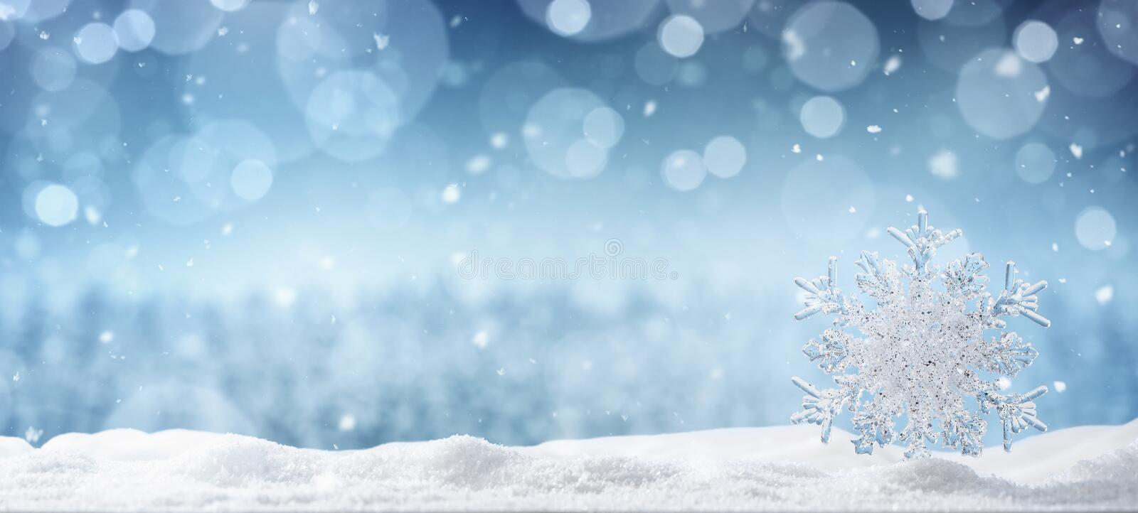 Crystal snowflake in the snow stock photos