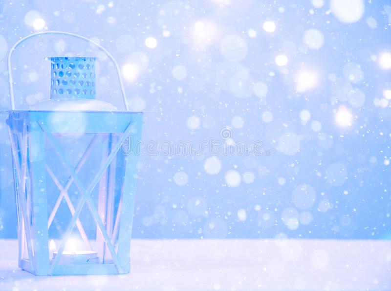 Winter background with lantern lamp, snowfall and copy space. Merry Christmas and Happy New Year stock image